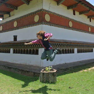 Woman Jump Shot at a fertility temple in Bhutan while solo traveling for work