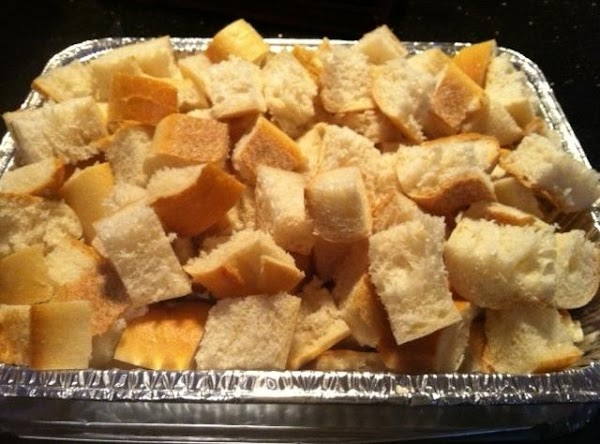 GREASE 13X9 BAKING DISH OR A LASAGNA SIZE TIN PAN. FILL WITH CUBED BREAD.