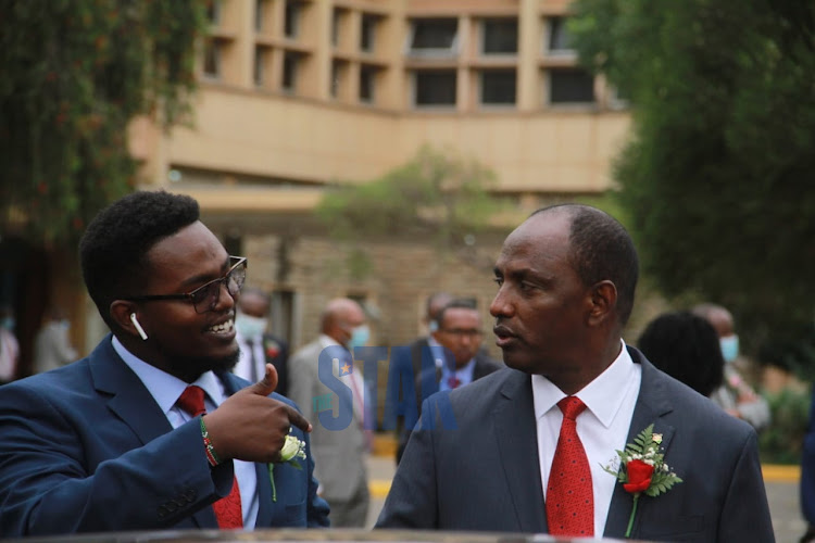 Treasury CS Ukuru Yatani with one of his sons - Ibrae - outside Parliament on June 11, 2020.