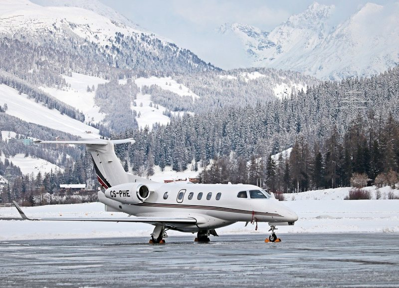Plane Landing on Snowy Runway