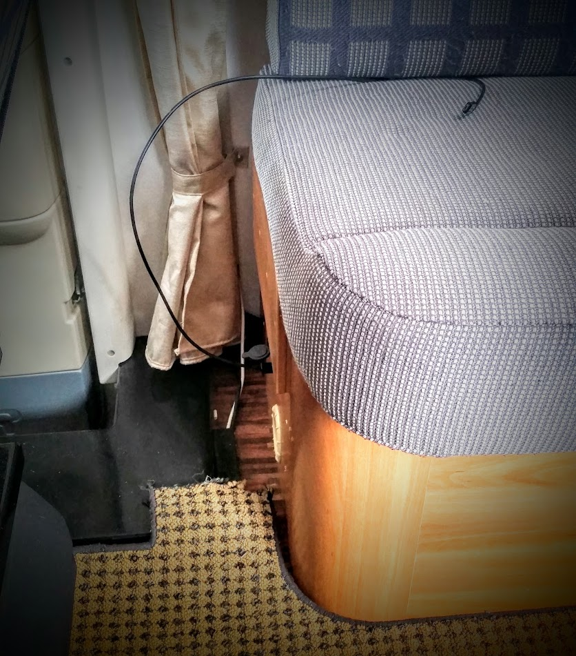 Double USB socket and a 12V socket in the sofa, behind the driver.