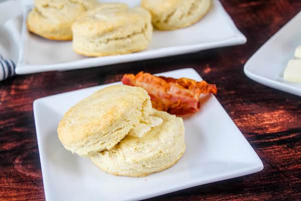 Foolproof Fluffy Butter Biscuits With A Pat Of Butter.