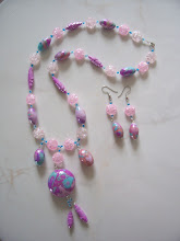 "Photo: PCM- 102 Necklace and earrings set. Polymer Clay beads and glass beads. 25"", $89.00"