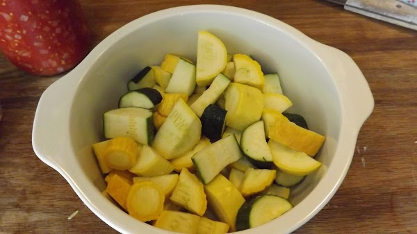 Cut squash into small chunks and place into a glass baking dish.