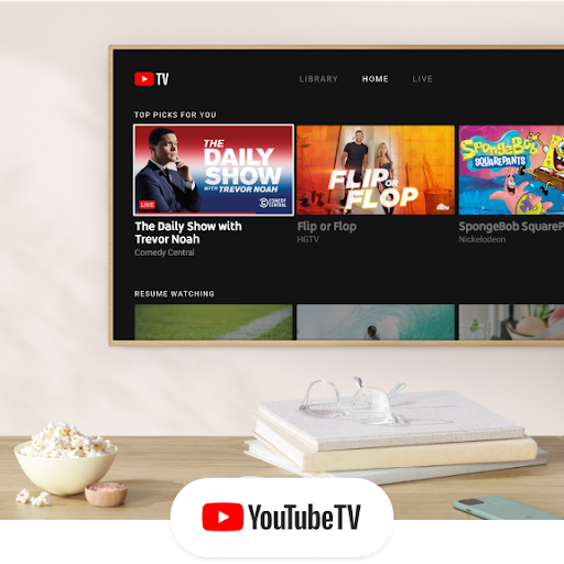 A television shows the YouTube TV interface.