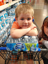 Photo: The Nestle Pure Life Juniors display was right at eye level and we spotted it first. These bottles were the perfect size for back to school lunches so we picked up a case. My son wanted to show how strong he was so he insisted that he hold them himself.