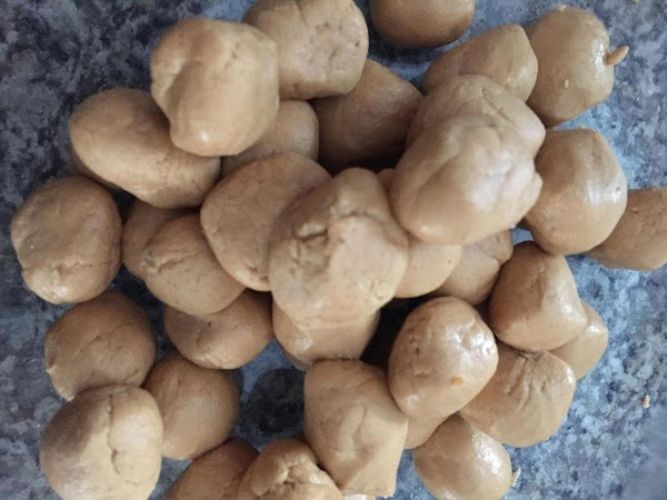 While cookies are baking. Combine peanut butter,  peanuts, and powdered sugar in a...