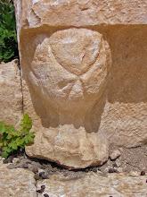 Photo: Rhodiapolis, Theater, detail of the seats .......... Detail van de zetelpoot in het Theater