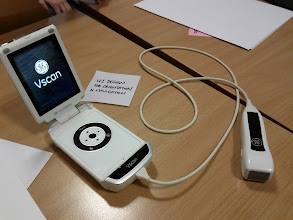 Photo: GE's Vscan handheld ultrasound device. I got to look at my heart. The Post It is for scale.
