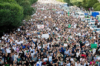 Photo: EDITORS' NOTE: Reuters and other foreign media are subject to Iranian restrictions on leaving the office to report, film or take pictures in Tehran.     Protesters march during a silent demonstration against the results of the Iranian presidential election in central Tehran June 18, 2009. Tens of thousands of Iranians, wearing black and carrying candles, marched on Thursday to mourn those killed in mass protests against a presidential election they and defeated Iranian presidential candidate Mirhossein Mousavi say was rigged.   REUTERS/Demotix  (IRAN CONFLICT ELECTIONS POLITICS IMAGES OF THE DAY)   Original Filename: 2009-06-18T163015Z_01_TOR98s_RTRMDNP_3_IRAN-ELECTION.JPG