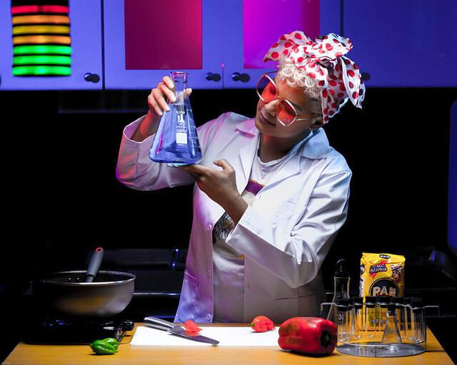"""Nery Santaella from Art for Impact in the """"Laboratorio de Arepas"""" (Arepas Lab), a Sci-fi themed cooking show using pop culture to hold humorous cultural discussions between Colombians and Venezuelans to deter xenophobia, while discussing shared history, culture, and gastronomy."""