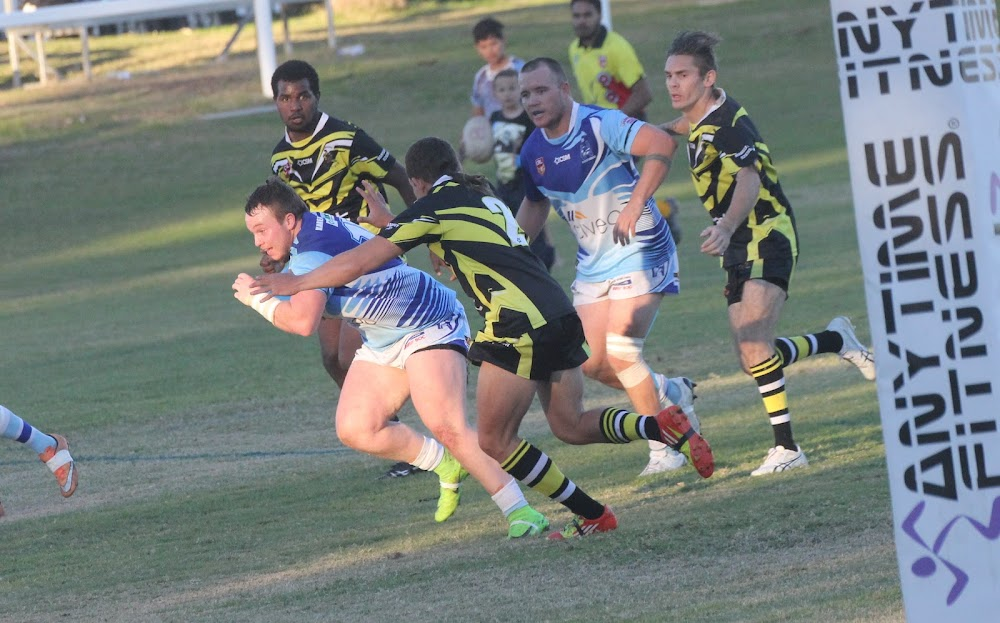 Narrabri's Sam Sadler charges towards the line as skipper Sean Russ watches on in the last match between Narrabri and Collegian, which was a 126-6 win for the Blues at Collins Park back in round nine in July.