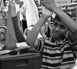 Photo: A young boy cheers on as pro-Palestine chants echo in downtown Toronto.