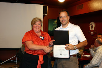 Photo: RVC Membership Cathy Godin presented last year's membership chair Phil Lemieux with the Red Ribbon Award for his efforts
