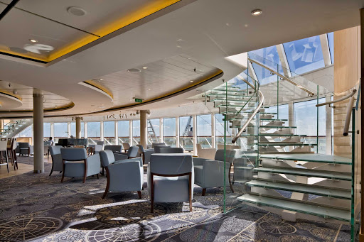 Viking-Star-Explorers-Lounge.jpg - Read rare books or inspect ship models in the two-deck Explorers' Lounge on Viking Star.