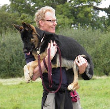 Photo: Richard with Stanley German Shepherd in his arms.