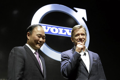 Vehicle for growth: Li Shufu, left, chairman of Zhejiang Geely Holding Group, and Volvo CE Hakan Samuelsson attend Volvo's S90 news conference in Shanghai, China. The Picture: REUTERS