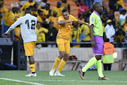 Ryan Moon of Kaizer Chiefs celebrates scoring the last penalty kick with teammates during the Telkom Knockout Last 16 match Kaizer Chiefs and Black Leopards at FNB Stadium on October 21, 2018 in Johannesburg, South Africa.