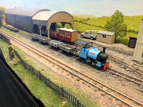 Photo: 013 The workmen's passenger rake has been returned to the shed whilst 0-4-0ST Bagnall Karen shunts empty wagons ready for loading at the processing works .