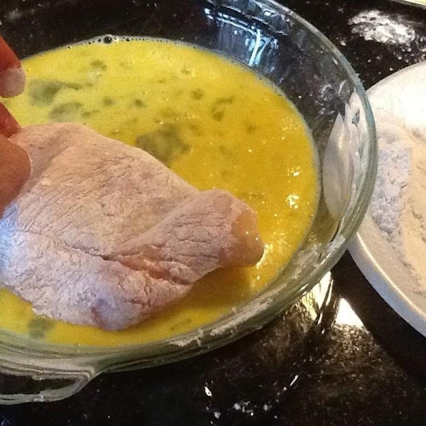 HEAT 1/2 THE OLIVE OIL IN A LARGE PAN...NOW DIP ONE PIECE OF CHICKEN...