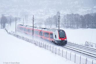 Photo: Norwegian State Railways (NSB) BM75 FLIRT train running through snowy weather outside Drammen