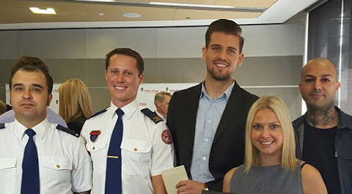 Liam McDermott, second from left, with paramedic partner Richard Torrens and cardiac arrest survivor Scott Winn and girlfirend.