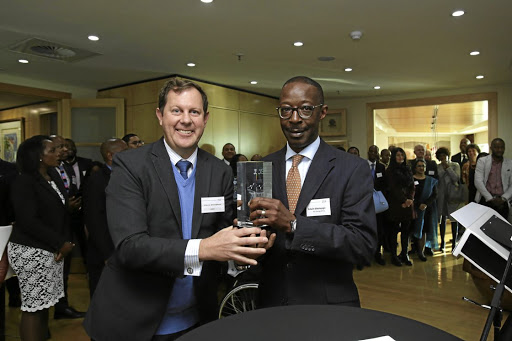 Clean energy: Chris Sturgess, left, director of commodities and key clients at the JSE with Edwin Kikonyogo, CEO of AEP Energy Africa. Picture: SUPPLIED