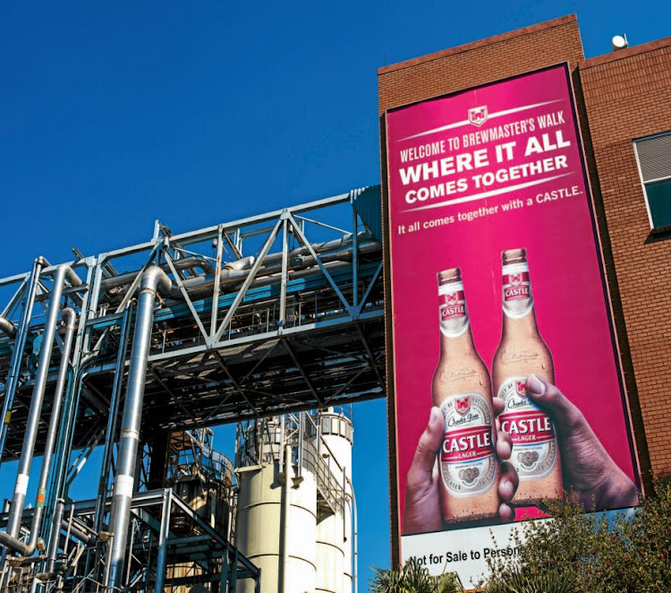 A sign advertising Castle Lager stands on an exterior wall at the SABMiller Alrode brewery and bottling plant. Picture: BLOOMBERG