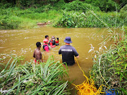 Divers from the Durban police and the metro police search and rescue units were frantically searching for nine-year old Amahle Mvuyo at H Section' Umlazi.