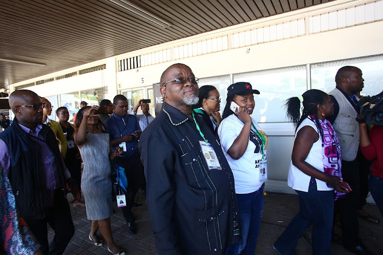 Gwede Mantashe walks to the media centre to address the media for the last time as the ANC Secretary General during the 54th ANC National Elective Conference.