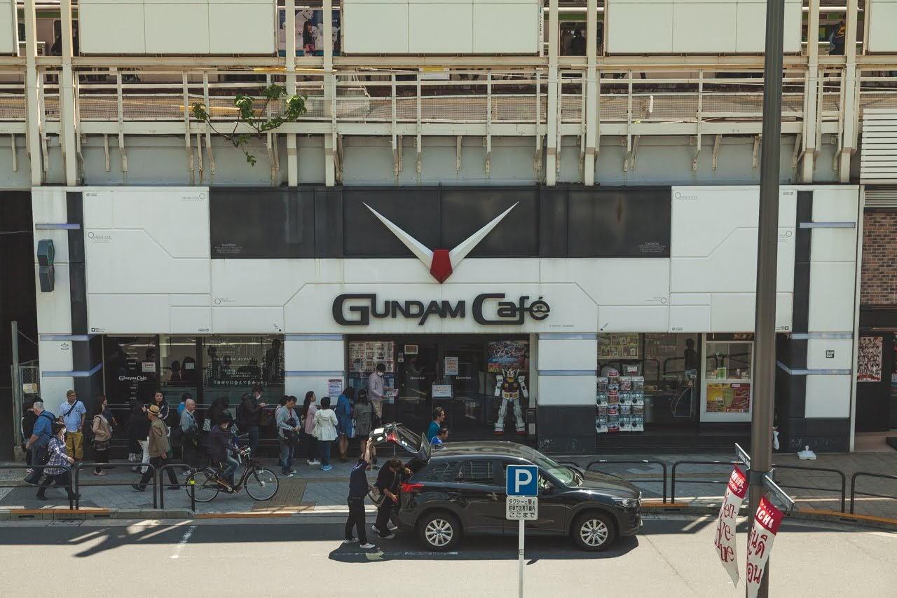 A line of people waiting to get inside the Gundam Cafe