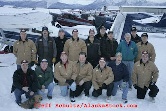 "Photo: Saturday February 17th 2007 At Merrill field in Anchorage, A potion of the ""Iditarod Air Force"" Volunteer bush pilots gather for a group photo prior to a day of flying straw and musher supplies to checkpoints along the race."