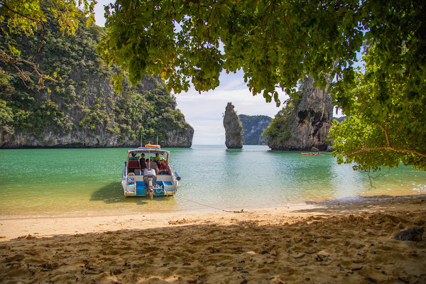 Relax at a small beach in the hidden lagoon of Kudu Yai Island