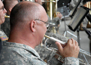 Photo: 1st Sgt. Larry Clatt played the trumpet during the 34th Red Bull Infantry Division Band's performance at the Minnesota State Fair's Military Appreciation Day Aug. 30, 2011 in St. Paul, Minn.