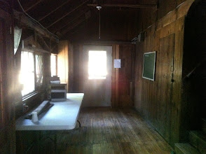 Photo: Side Room of the Dining Hall, with stairs upstairs.