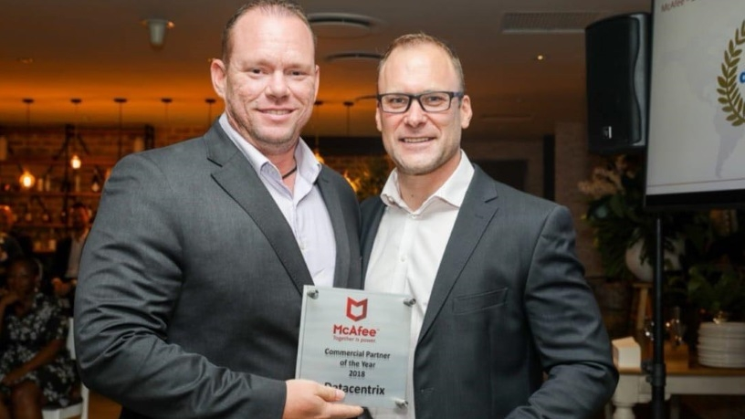 Trevor Coetzee, regional director for sub-Saharan Africa at McAfee (right), congratulates Wayne Olsen, security business unit manager at Datacentrix, on the company's recent win.