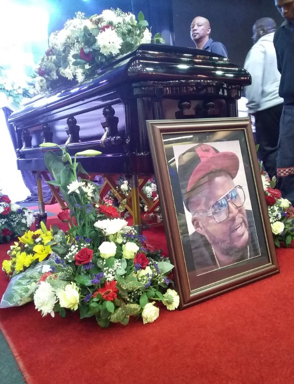 A picture of Jabulani 'HHP' Tsambo next to his coffin during his funeral.