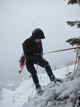 Photo: Jeff on the first of three rappels while the heavy snow started falling.