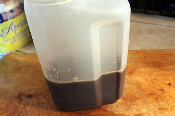 Add instant coffee, sugar or sweetener, and chocolate syrup to the water.