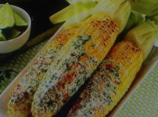 When corn is done. Spread mixture on the cooked corn... and serve,with lime wedges.  and sprinkle...