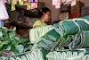 Indonésie. Cours de cuisine de Bali. Feuilles de bananier au marché