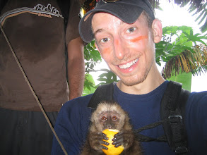 Photo: We stopped at a little hut where a native was selling fresh coffee from the fields for $0.20, or you could buy an imported American candy bar like a snickers for $2.50. Also, they had a monkey. The stuff on my face is from a plant that supposedly deters bug bites