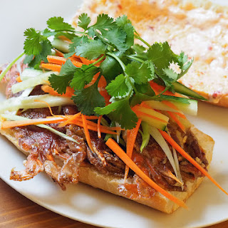 Sautéed Soft-Shell Crab Sandwiches With Pickled Vegetables, Cilantro, and Ginger-Chili Mayo.
