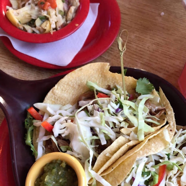 My daughter got the pork tacos on corn tortillas minus the cheese.  Her side was marinated artichokes.  Our server Sarah was knowledgeable and helped us make good choices!