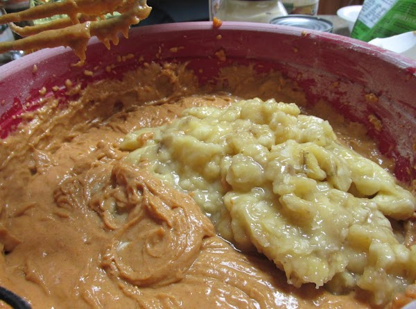 Stir in mashed bananas and chopped nuts, remove beaters and combine with a large...