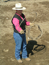 Photo: With your right hand (if you are right-handed) near the hondo, you will flip this little loop up & back, over your fore arm/wrist.