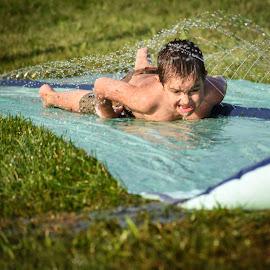 by Tiffany Serijna - Babies & Children Children Candids ( candid, outside, tiffanyserijna, slide, sun, water, boy, fun )