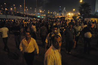 Photo: Protesters run from another barrage of tear gas from the military and Central Security Forces...