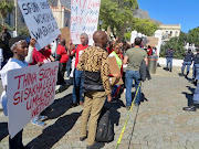 Dozens of representatives from various rural and township organisations from across the country protested outside Parliament on Tuesday over land redistribution.