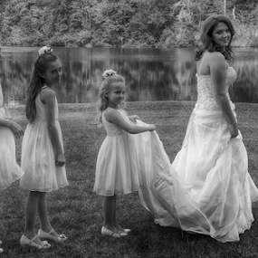 The White Trail by Janice Mcgregor - Black & White Portraits & People ( water, girl, b&w, grass, trees, landscape, bride, white dresses, flower girls, portrait, outside, wedding portrait )